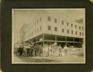 Untitled photograph of construction workers in front of a downtown Portland Oregon construction...